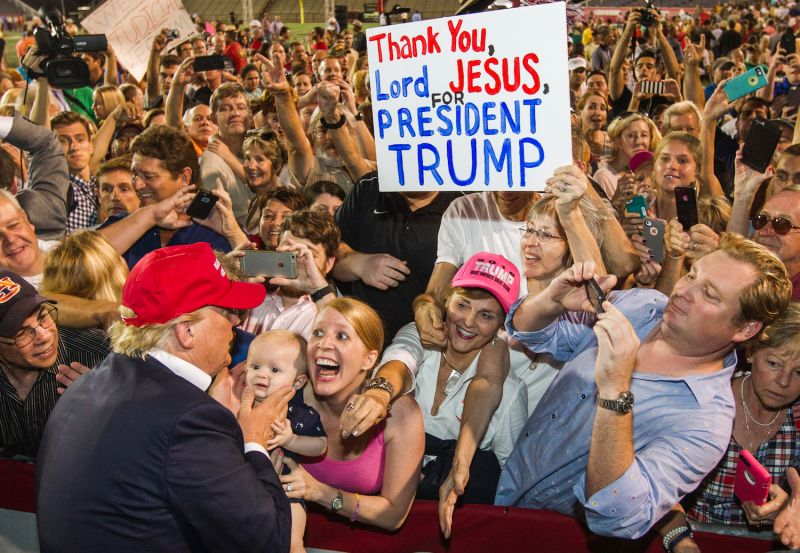Republican presidential candidate Donald Trump greets supporters after a rally at Ladd-Peebles Stadium in Mobile on Aug 21, 2015.