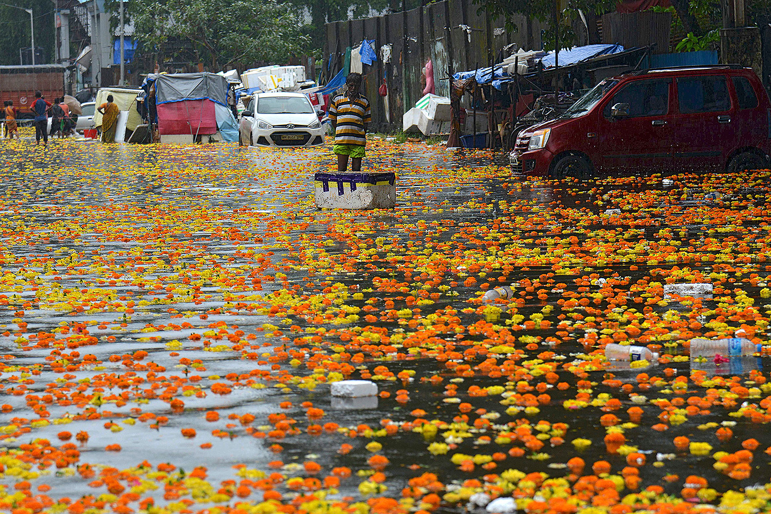 A vendor stands in a flooded flower market following heavy monsoon rains in Mumbai on Sept. 23. SUJIT JAISWAL/AFP via Getty Images