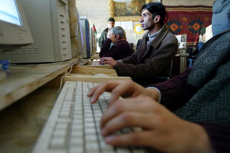 Afghans use computers at the Park Residence Internet Cafe in Kabul on Jan. 20, 2003.