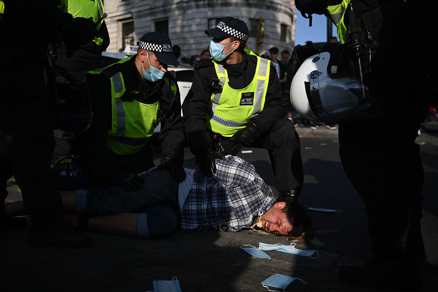 A demonstrator at an anti-vax rally is arrested following clashes with police officers at Trafalgar Square, central London, on Sept. 19. DANIEL LEAL-OLIVAS/AFP via Getty Images