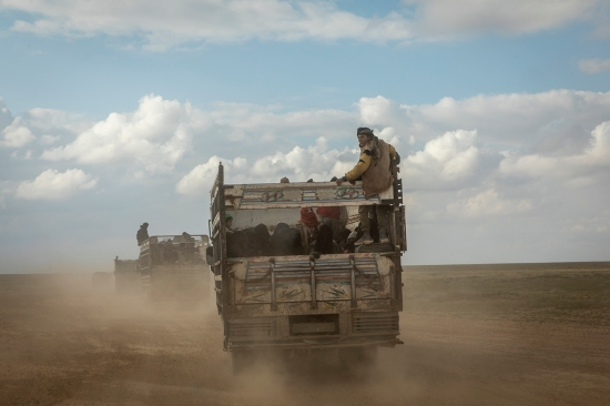 A convoy drives in eastern Syria.