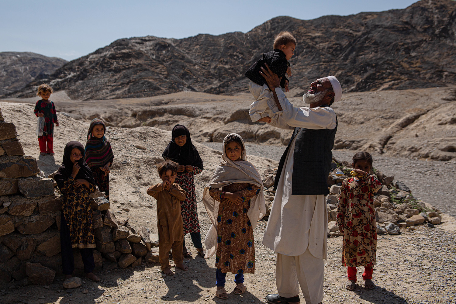 Villagers in Nangarhar's Momand Dara district on Sept. 19. The rural-urban divide in Afghanistan has caused widespread frustration with people in rural areas saying they lack access to services such as education and health care.