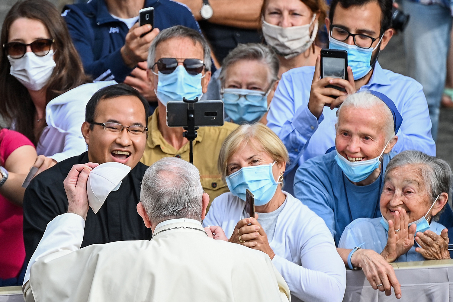 Pope Francis arrives to his first limited public weekly audience since the pandemic began at the San Damaso Courtyard in the Vatican on Sept. 2. VINCENZO PINTO/AFP via Getty Images