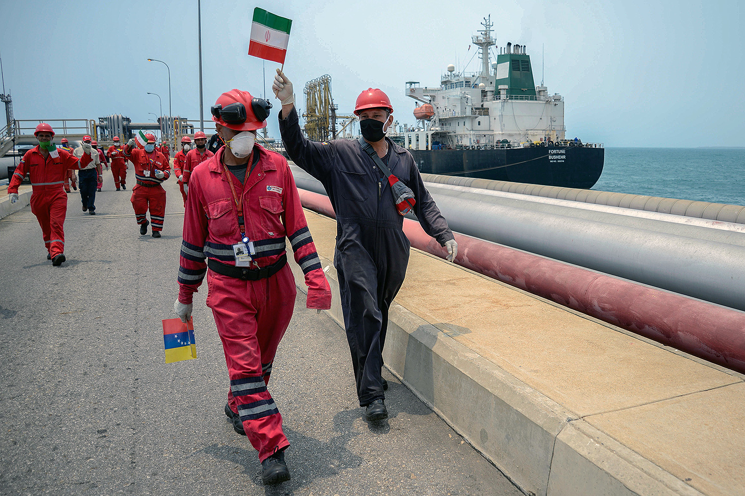 A Venezuelan oil worker waves an Iranian flag.