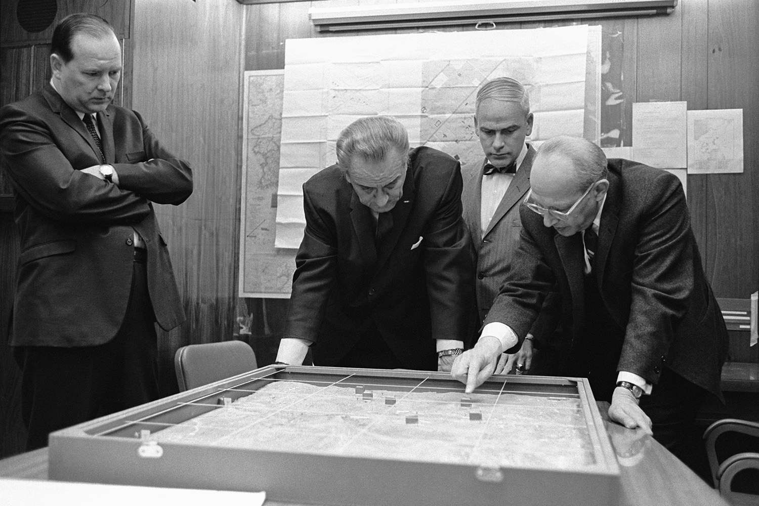 U.S. National Security Advisor Walt Rostow shows President Lyndon Johnson options for a military attack on a site in Vietnam during the Vietnam War from the Situation Room at the White House in 1968.