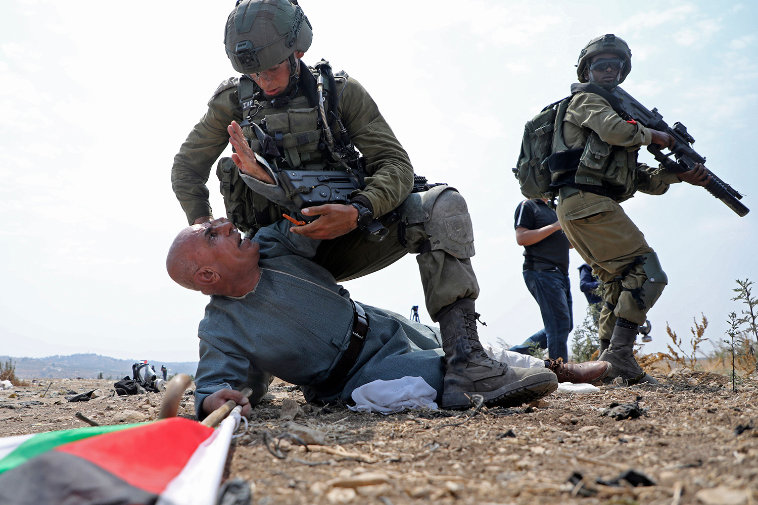 Israeli soldiers detain a Palestinian protester during a demonstration against the Israeli settlement expansion in the village of Jbara, south of Tulkarm, in the occupied West Bank on Sept. 1. JAAFAR ASHTIYEH/AFP via Getty Images