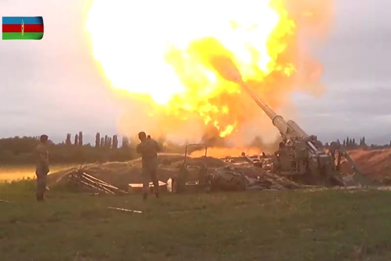 A video still shows members of Azerbaijan's armed forces firing artillery during clashes between Armenia and Azerbaijan over the territory of Nagorno-Karabakh in an unidentified location, from footage released Sept. 28.
