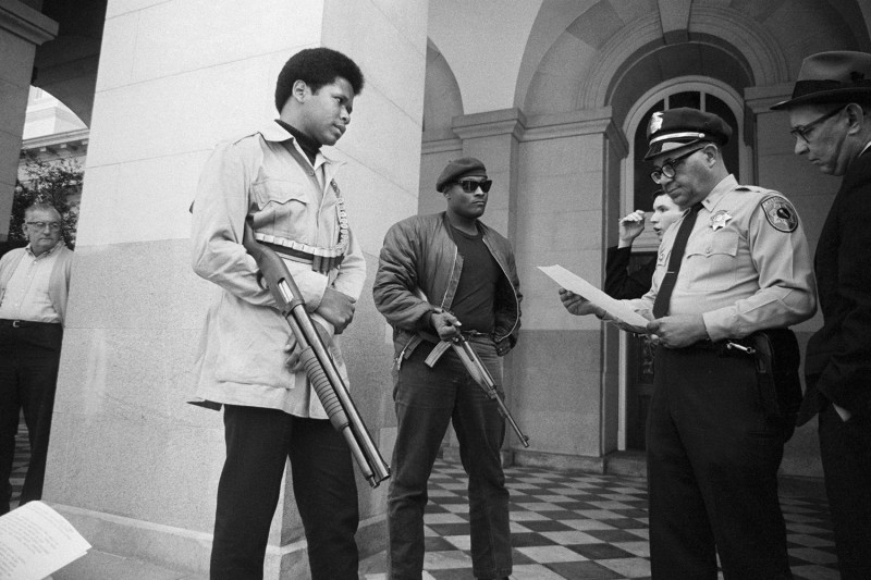 Two members of the Black Panther Party