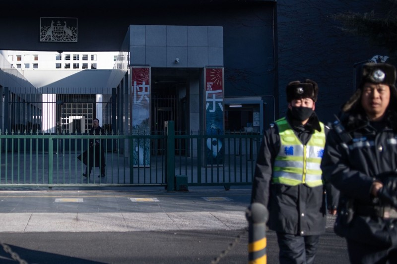 Chinese police patrol outside the Australian embassy in Beijing on January 25, 2019.