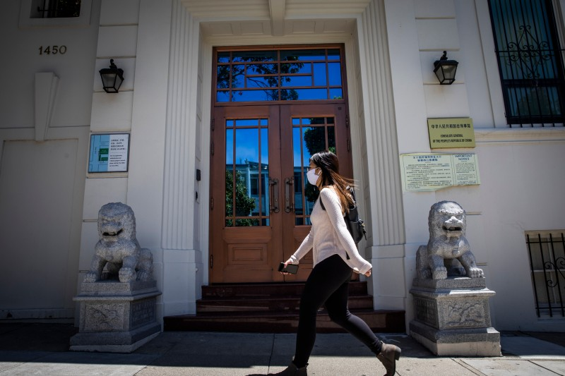 A person walks past the Chinese Consulate General in San Francisco, where one Chinese researcher is taking refuge from U.S. indictments, on July 23.