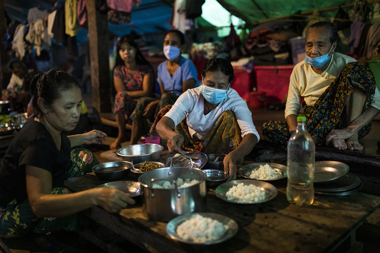 People prepare dinner at the Shitthaung camp for displaced people in Mrauk U, myanmar,