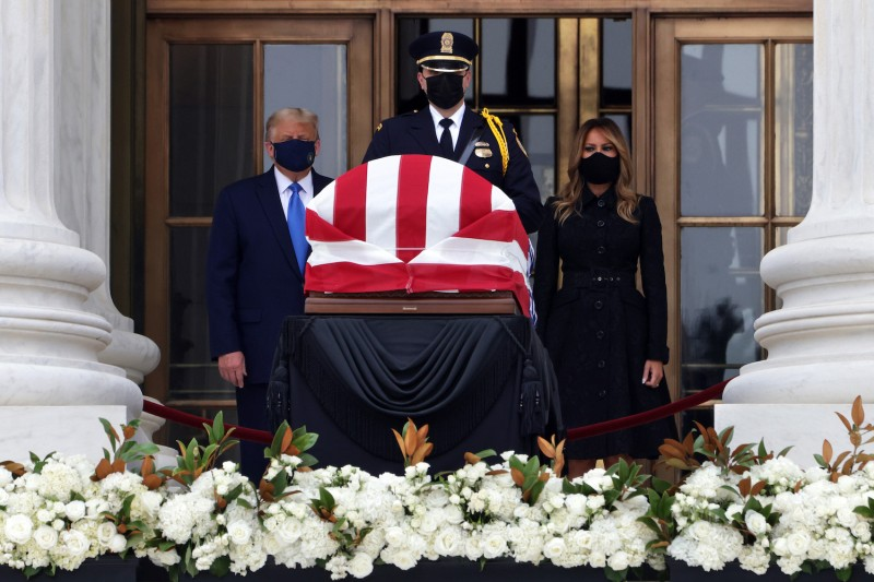 U.S. President Donald Trump and First Lady Melania Trump pay their respects to Supreme Court Justice Ruth Bader Ginsburg.