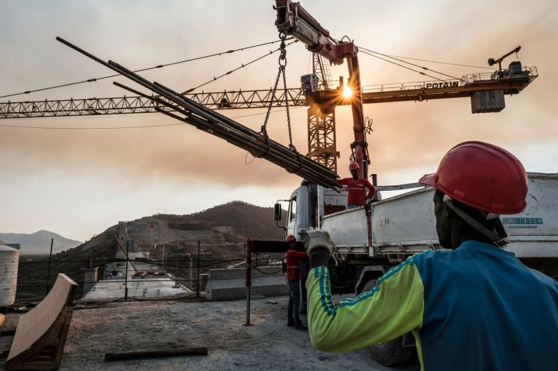 Workers move iron bars with a crane at the Grand Ethiopian Renaissance Dam, near Guba in Ethiopia, on Dec. 26, 2019.