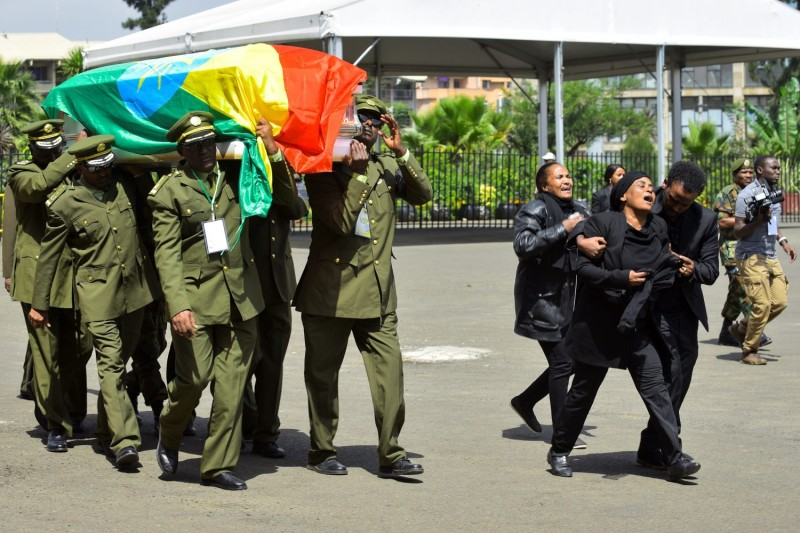 Members of the Ethiopian army carry a coffin at the national funeral service of Gen. Seare Mekonnen, the chief of staff of the Ethiopian defense forces, and Maj. Gen. Gezae Abera in Addis Ababa on June 25, 2019.