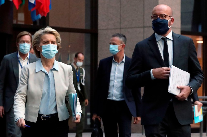 European Council President Charles Michel and European Commission President Ursula von der Leyen arrive for a news conference after a virtual summit with Chinese President Xi Jinping.