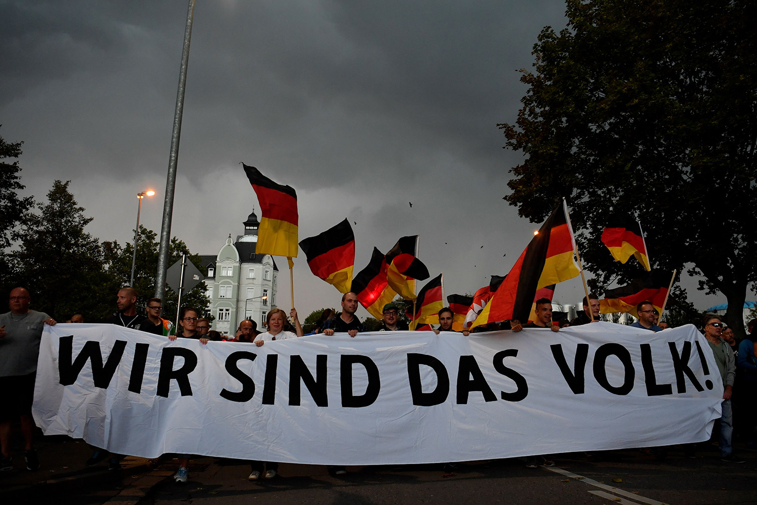 "Protesters hold a giant banner reading ""we are the people"" during a march organized by the right-wing populist Pro Chemnitz movement in Germany on Sept. 7, 2018. Germany is among European countries in which other parties exclude extremists from government coalitions."