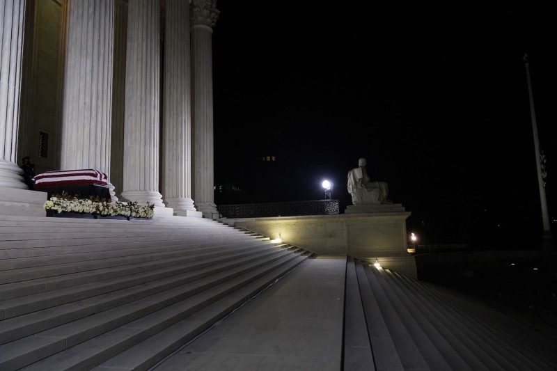 The flag-draped casket of Justice Ruth Bader Ginsburg lies in repose at the top of the front steps of the U.S. Supreme Court in Washington, DC on Sept. 24.