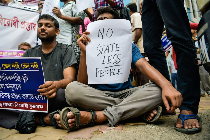 "A protester holds a sign that reads ""NO STATELESS PEOPLE"" during a protest against the National Register of Citizens in Kolkata, India, in September 2019."