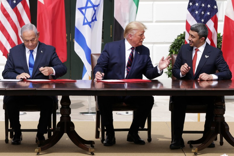 Prime Minister of Israel Benjamin Netanyahu, U.S. President Donald Trump, and Foreign Affairs Minister of the United Arab Emirates Abdullah bin Zayed bin Sultan Al Nahyan participate in the signing ceremony of the Abraham Accords on the South Lawn of the White House on Sept. 15.