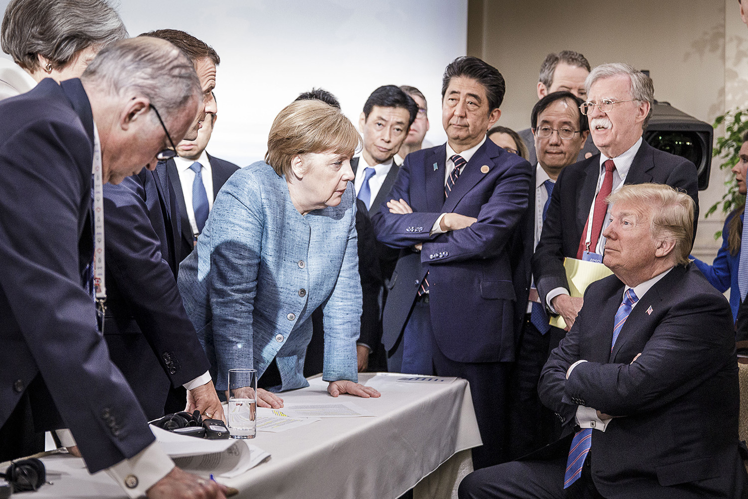 In a photo provided by the German Government Press Office, German Chancellor Angela Merkel deliberates with U.S. President Donald Trump on the sidelines of the G-7 summit in Charlevoix, Canada, on June 9, 2018.