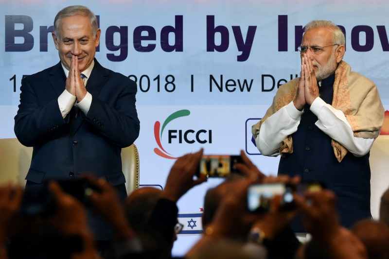 Indian Prime Minister Narendra Modi and Israeli Prime Minister Benjamin Netanyahu greet during the India-Israel Business Summit in New Delhi on January 15, 2018.