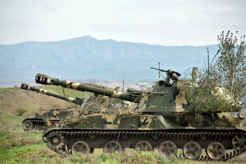 Mobile artillery units of the self-defence army of Nagorno-Karabakh hold a position outside the settlement of Hadrut, on April 5, 2016.