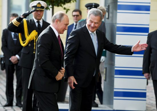 Finnish President Sauli Niinisto welcomes Russian President Vladimir Putin as he arrives at the Presidential Palace in Helsinki on Aug. 21, 2019.