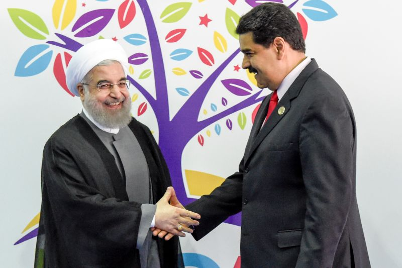 Iranian President Hassan Rouhani (left) greets Venezuelan President Nicolas Maduro before the opening ceremony in the Non-Aligned Movement summit in Venezuela, on Sept. 17, 2016.