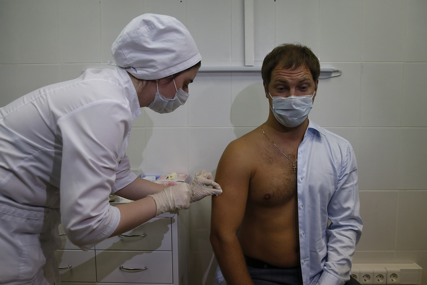 A volunteer doctor administers a trial version of the COVID-19 vaccine in Moscow on Aug. 11.