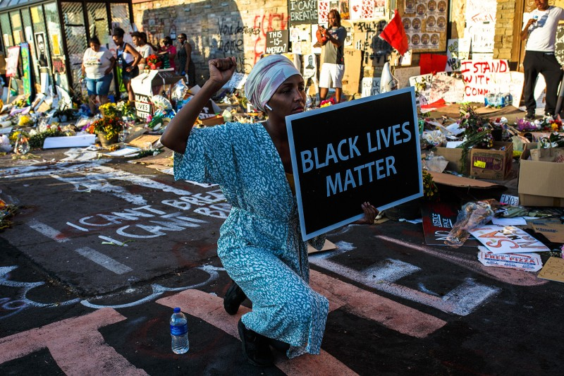 A Somali American protester kneels during a call for justice for George Floyd, a Black man who was killed by police, in Minneapolis on June 1.