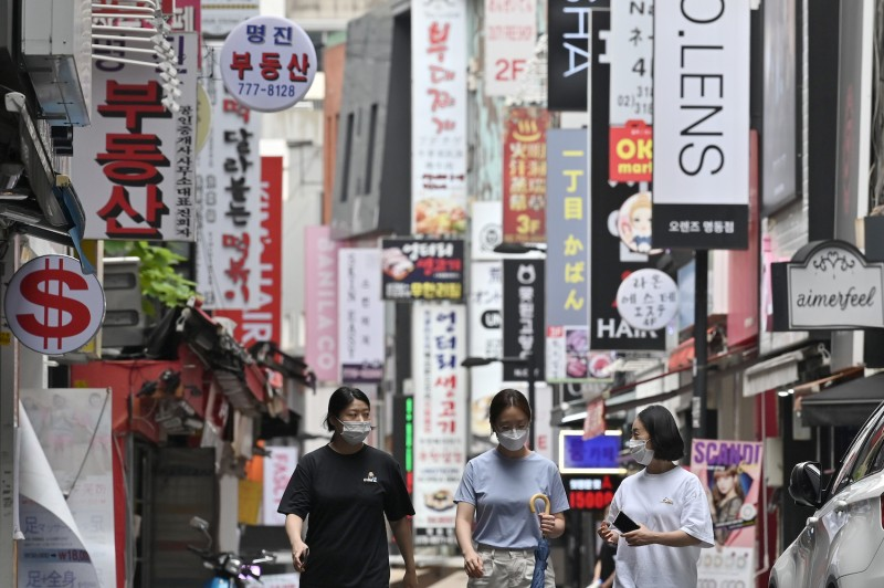 People walk through the Myeongdong shopping district.