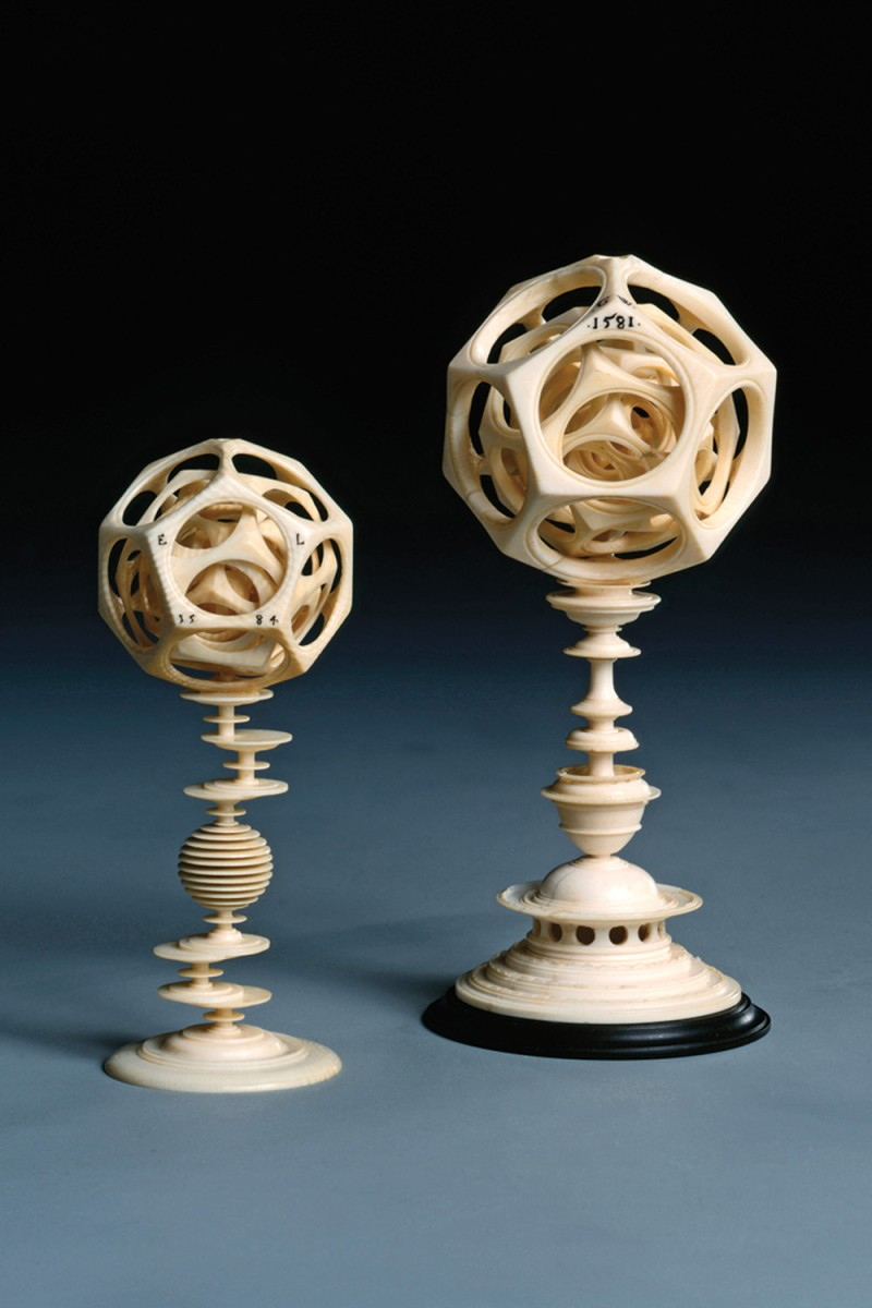Carved ivory polyhedra by Egidius Lobenigk (left) and Georg Wecker from the 16th century, part of the Staatliche Kunstsammlungen Dresden collection in Germany.