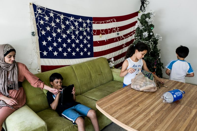 The al-Zoobi family spends time together at their home in Bloomfield Hills, Michigan, on July 26, 2015. They fled Syria three years before.