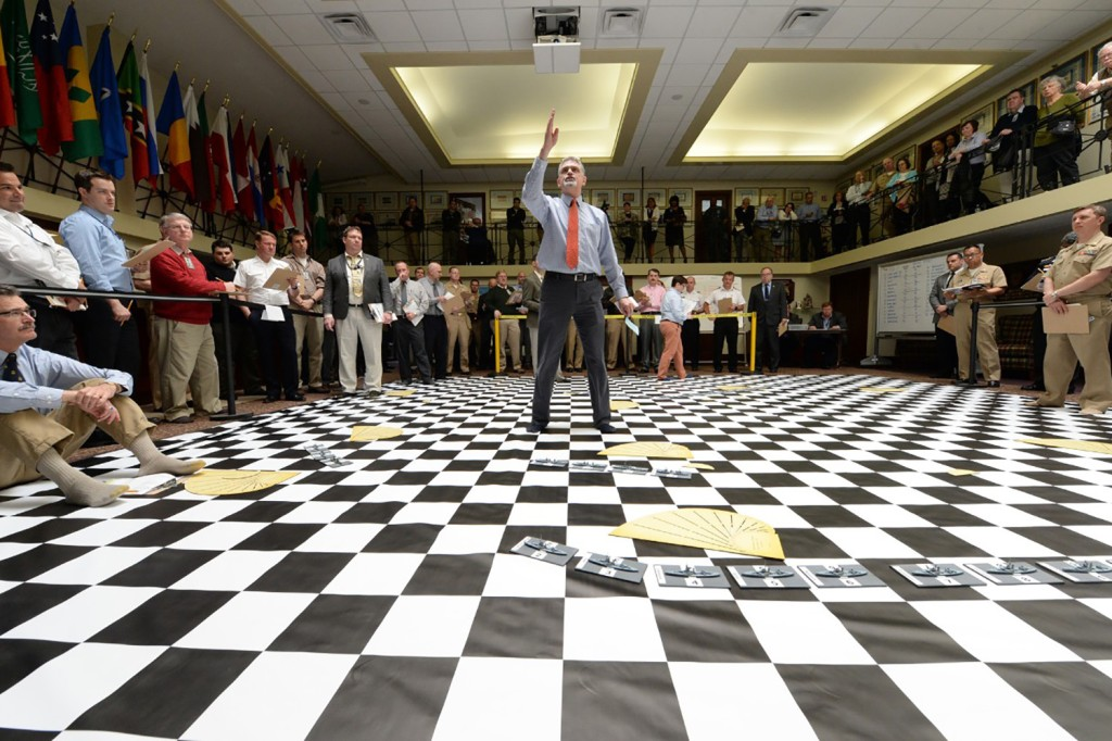 Peter Pellegrino, the U.S. Naval War College's senior military analyst for wargaming, briefs participants in a wargame reenactment of the Battle of Jutland on the college's tiled floor in Newport, Rhode Island, on May 10, 2016.