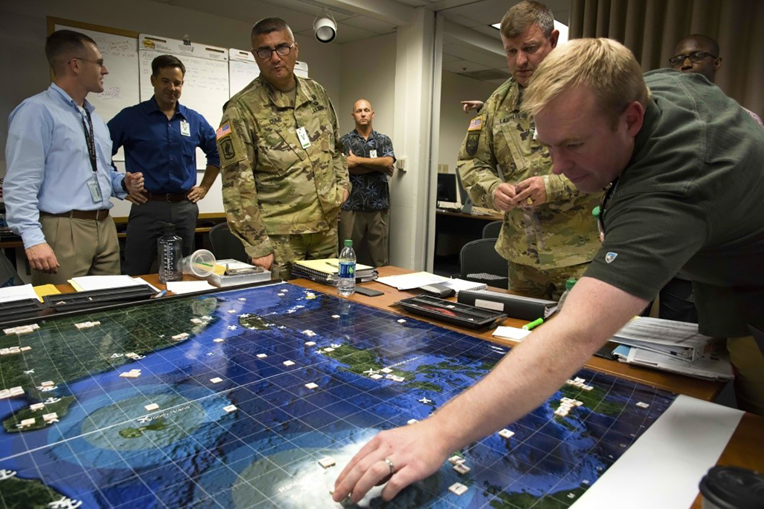 Naval Postgraduate School students participate in analytic wargames they designed to explore solutions for the Department of Defense's national security concerns in 2018.