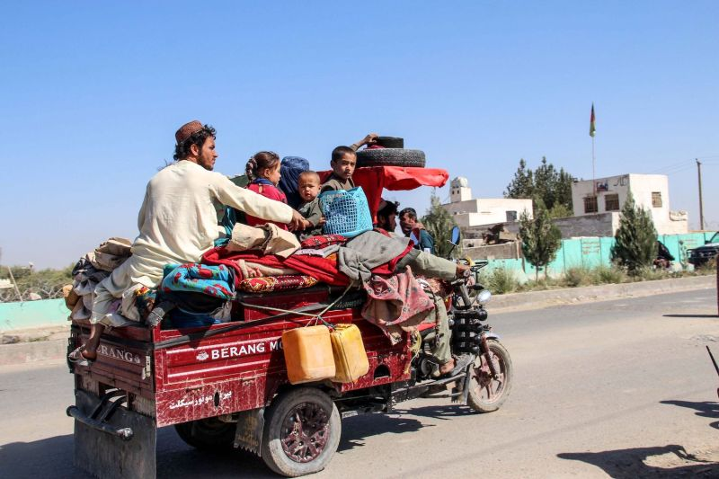Internally displaced people with their belongings flee from Nadali district to Lashkar Gah during the ongoing clashes between Taliban fighters and Afghan security forces in Helmand province on October 14, 2020.