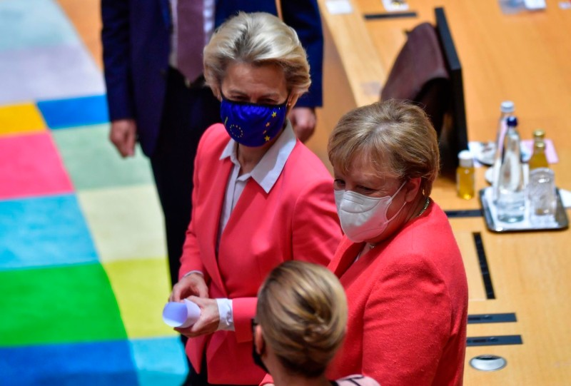 Germany's Chancellor Angela Merkel and European Commission President Ursula von der Leyen arrive for a roundtable meeting on the second day of a European Union (EU) summit on October 2, 2020.