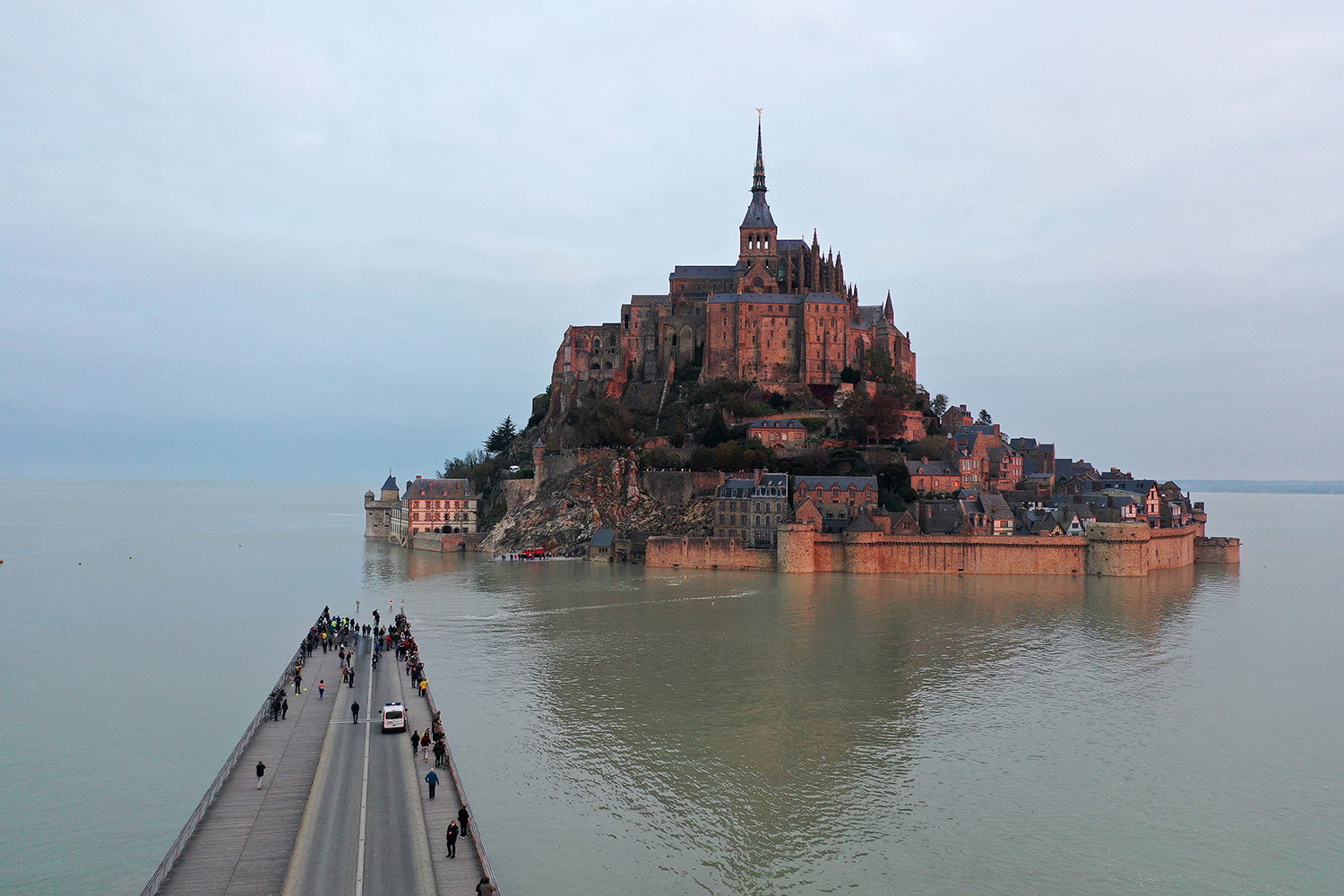 The Mont-Saint-Michel in Normandy, France, is cut off to visitors after its access road was flooded during high tide Oct. 18. DAMIEN MEYER/AFP via Getty Images