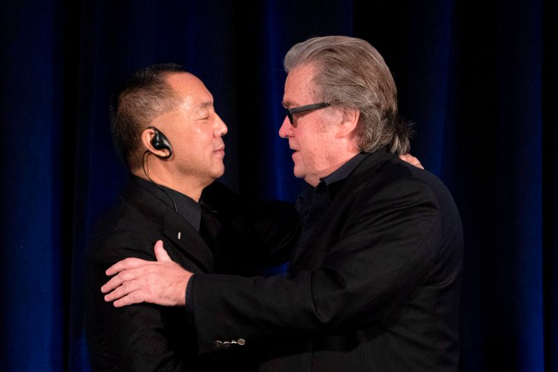 Former White House chief strategist Steve Bannon (right) greets fugitive Chinese billionaire Guo Wengui