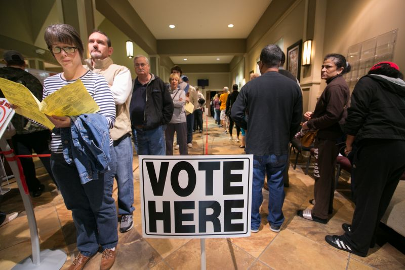 Voters line-up to cast their ballots at a polling station set up at Noonday Baptist Church for the mid-term elections on November 6, 2018 in Marietta, Georgia.