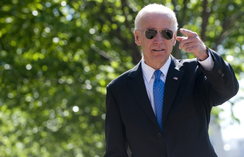 oe Biden walks to a meeting of bipartisan members of Congress to begin work on a legislative framework for comprehensive deficit reduction at Blair House, across the street from the White House in Washington on May 5, 2011.