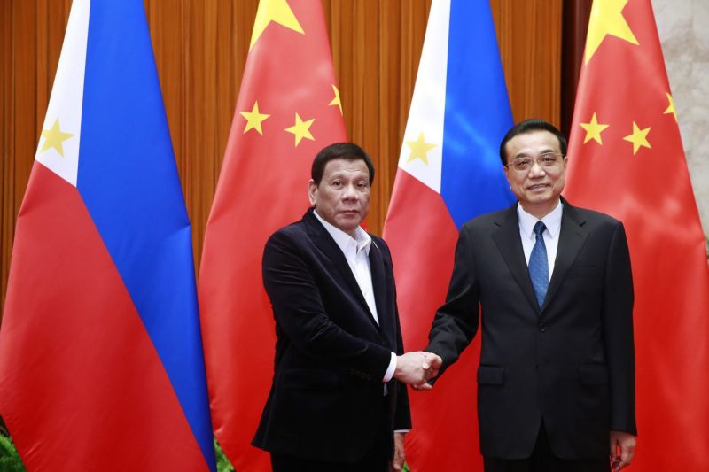 Philippine President Rodrigo Duterte (left) and Chinese Premier Li Keqiang shake hands during their meeting at the Great Hall of the People in Beijing on Aug. 30, 2019.
