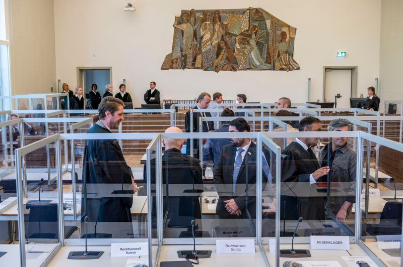 Joint plaintiffs are seen at the courtroom prior to the start of a trial against two Syrian defendants accused of state-sponsored torture in Syria, on April 23, 2020 in Koblenz, Germany.