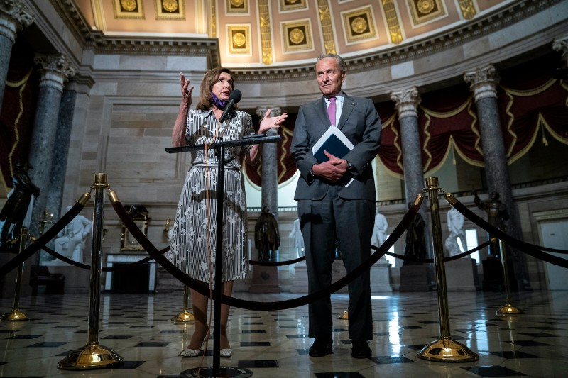 Speaker of the House Nancy Pelosi and Senate Minority Leader Chuck Schumer speak to reporters after they met with U.S. Treasury Secretary Steven Mnuchin and White House Chief of Staff Mark Meadows at the U.S. Capitol on July 28 in Washington, amid economic stimulus talks.