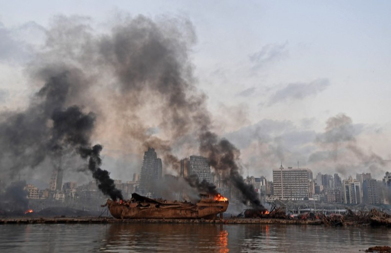 A ship in flames is pictured at the port of Beirut following a massive explosion that hit the heart of the Lebanese capital on Aug. 4.
