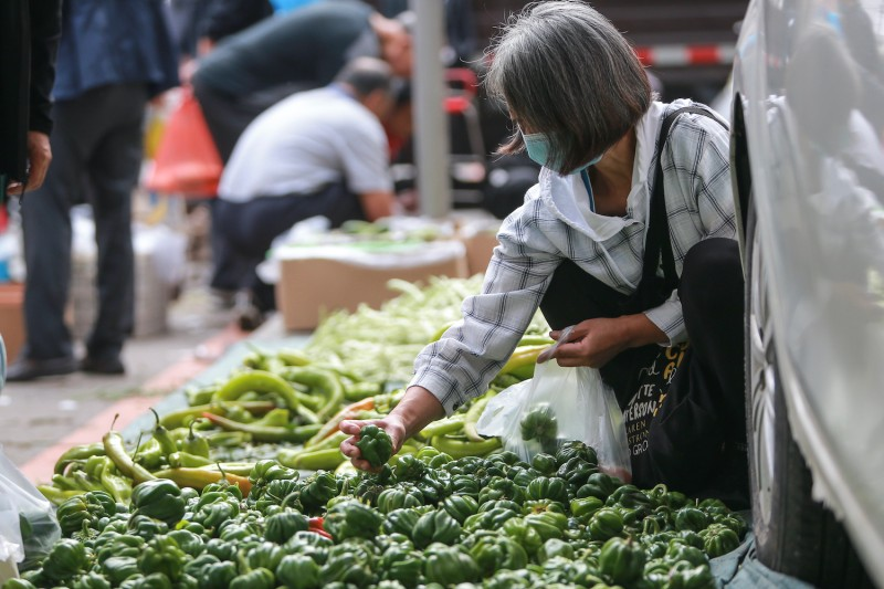 A customer shops for vegetables at a market in Shenyang, China, on Sept. 9.