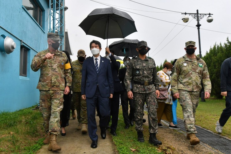 South Korean Unification Minister Lee In-young (second left) walks with military officers during a visit to the south side of the truce village of Panmunjom in the Demilitarized Zone dividing the two Koreas on Sept. 16.