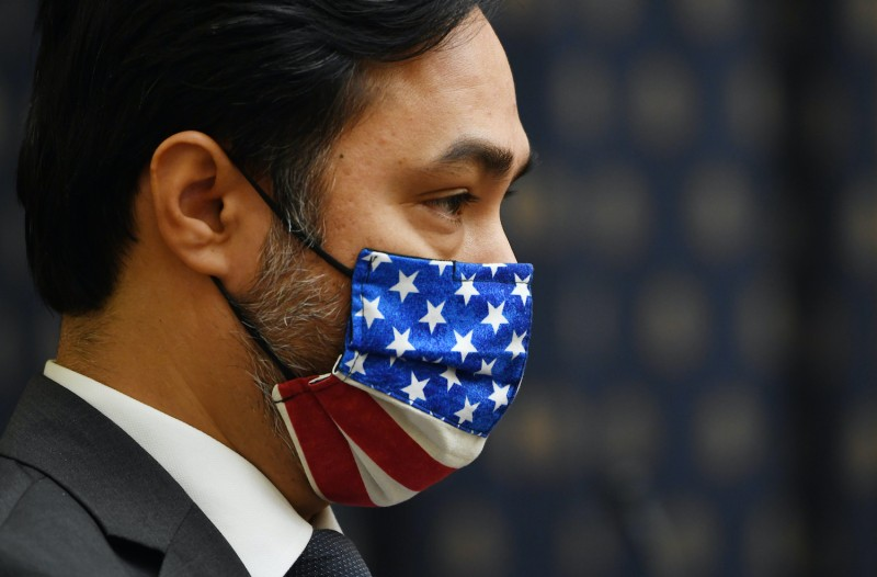 Rep. Joaquin Castro wears a face mask