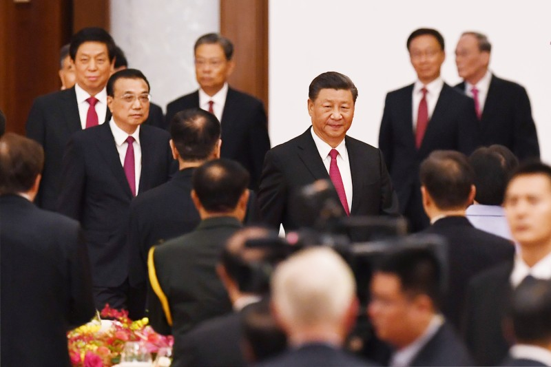 Chinese President Xi Jinping arrives with Premier Li Keqiang for a reception at the Great Hall of the People on the eve of China's National Day on Sept. 30.