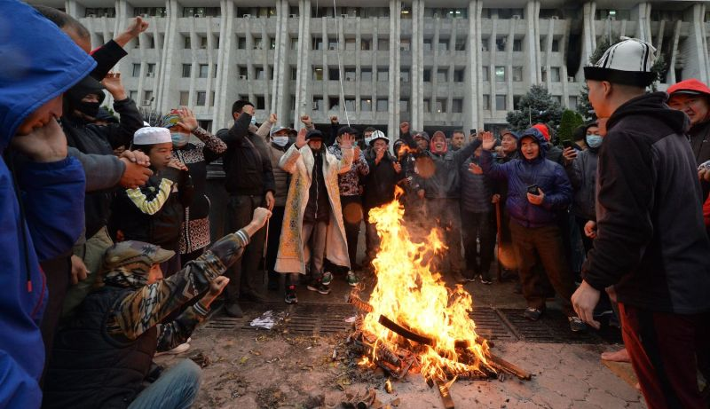 People protesting the results of the parliamentary vote gather by a bonfire in front of the seized main government building, known as the White House, in Bishkek, Kyrgyzstan, on Oct. 6.